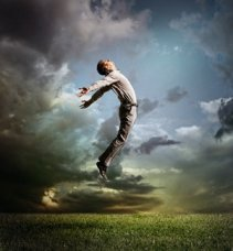 spiritual-beliefs_OMTimes_bigstock-Young-Man-Jumping-Up-To-Sky-71026729-s
