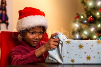 18178903-black-boy-opening-christmas-present